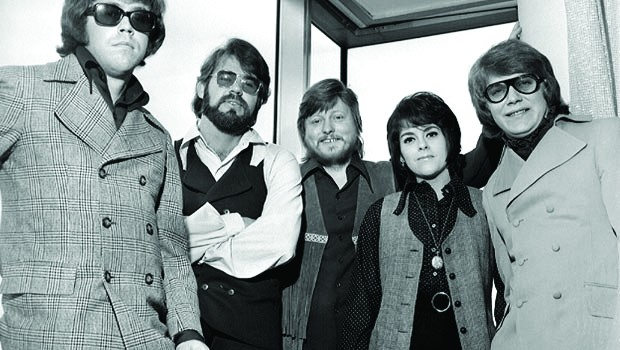 HIPPIE: Pink sunglasses and an earring formed Kenny Rogers' signature look during his time with the First Edition